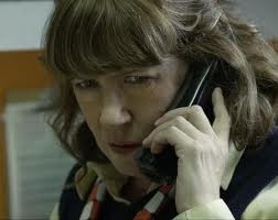 Ann Dowd, as the manager